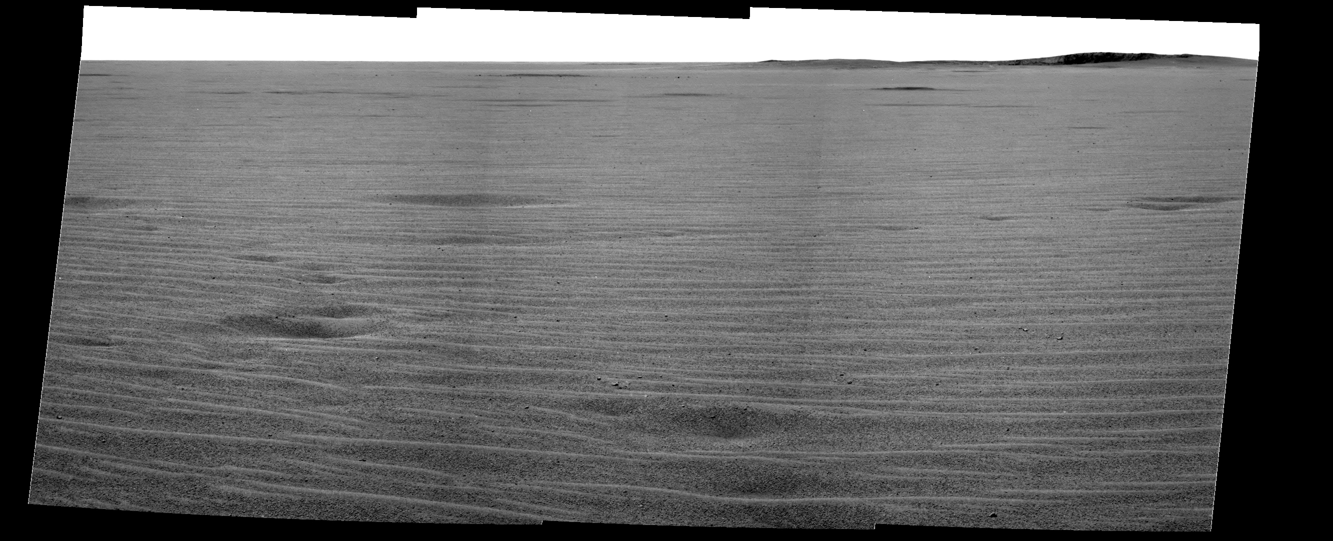 "Mars MER Opportunity The Path to Endurance This mosaic image from the Mars Exploration Rover Opportunity's panoramic camera provides an overview of the rover's drive direction toward ""Endurance Crater,"" which is in the upper right corner of image."