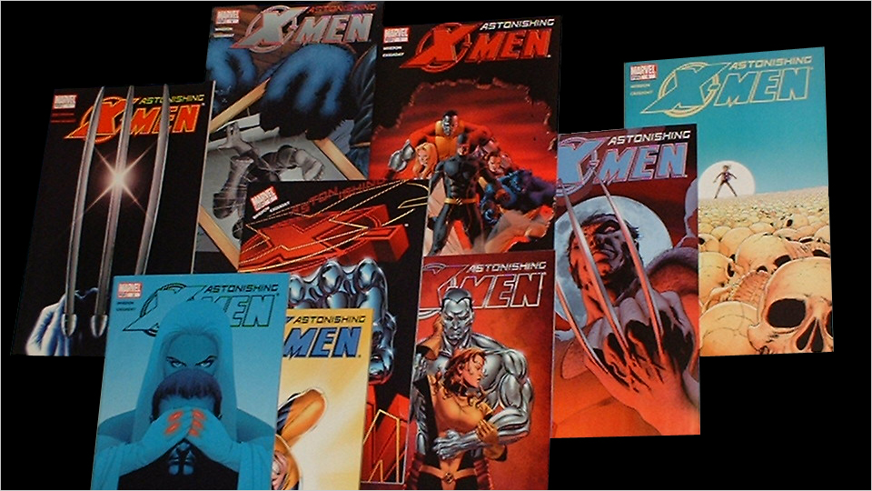 Several Astonishing X-Men comics laid out against black background