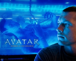 Promotional wallpaper from Avatar with Jake looking at his alien clone in a tank