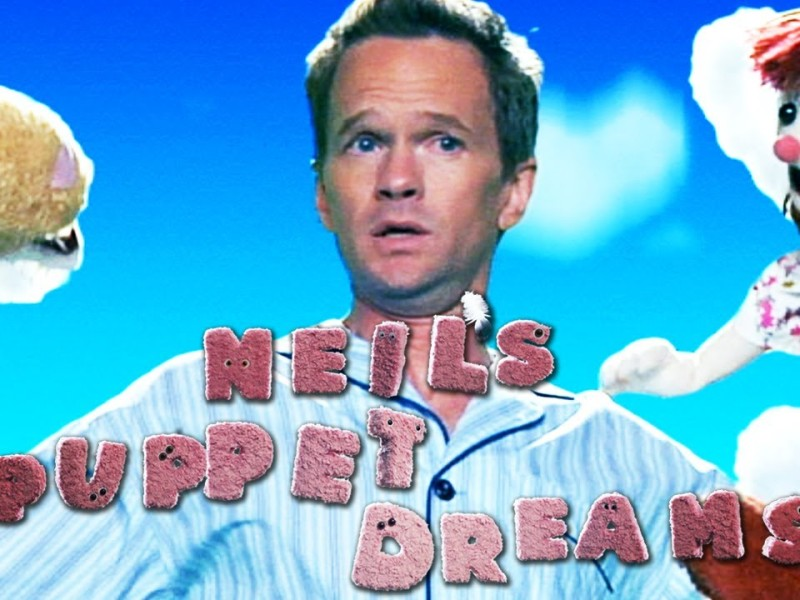 YouTube image of Neil's Puppet Dreams with Neil Patrick Harris alarmed between puppets