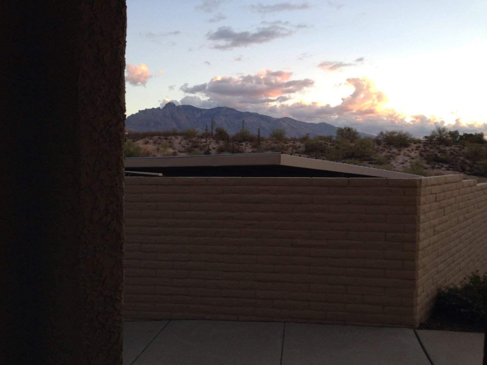 Brick wall in front of carport and mountains in Tucson, Arizona