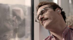 Movie still from Her with Theodore Twombly (Joaquin Phoenix) leaning against window during commute with advance ear pods in
