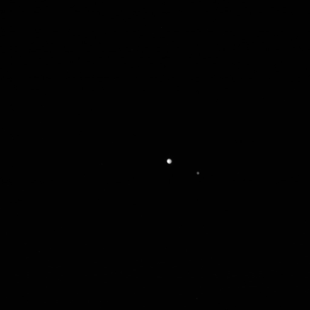 Pluto and Charon from 27.7 million kilometers, at 2015-06-21 04:59:45 UTC.