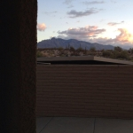 Link to fiction If Everyone Was Standing Outside My Door and image of my view of mountains outside my apartment in Tucson Arizona