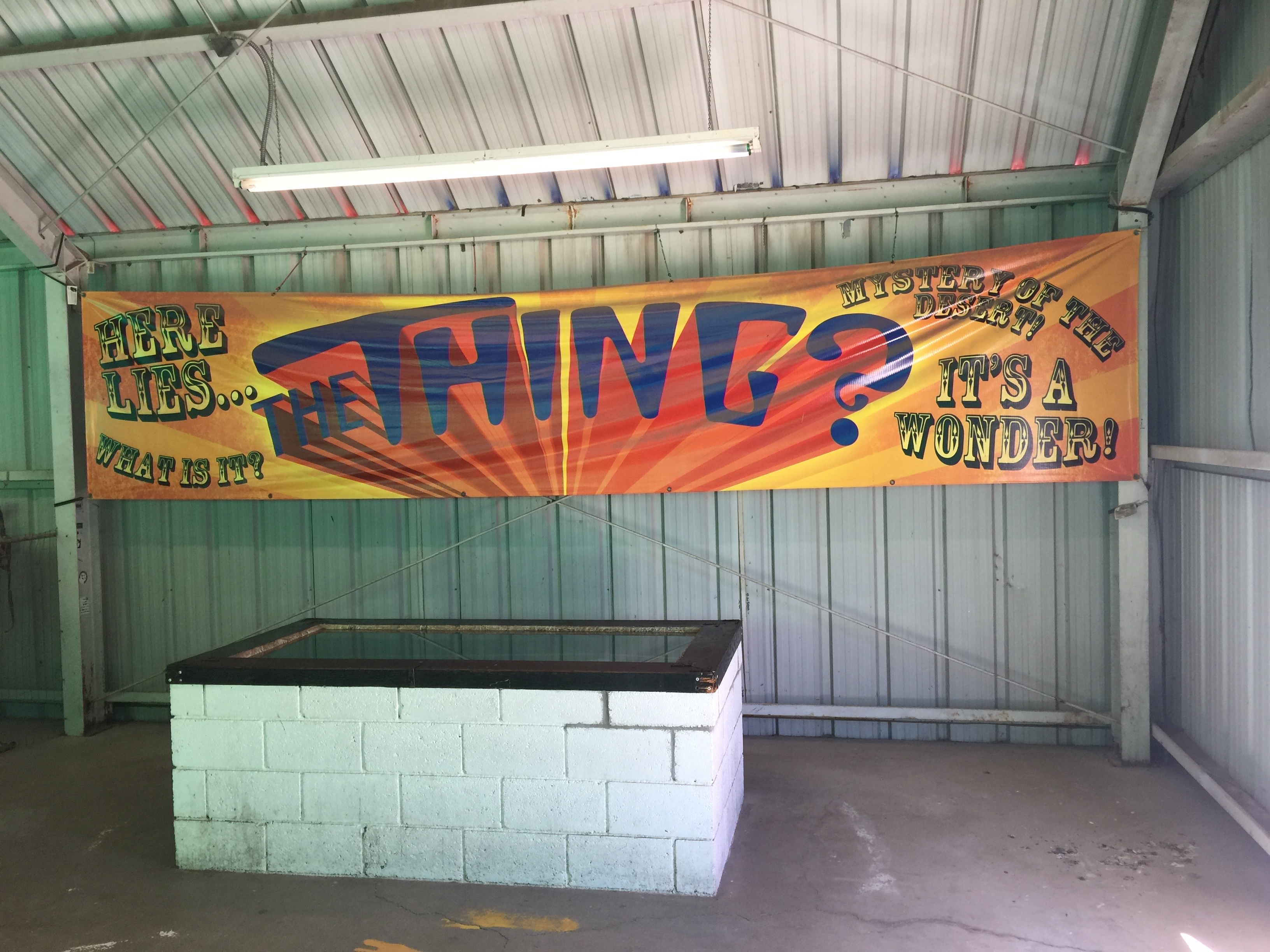 Banner and cinder-block coffin containing The Thing at Bowlin's The Thing? roadside attraction, March 18, 2017