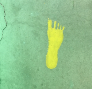 Yellow monster print on concrete at Bowlin's The Thing? roadside attraction, March 18, 2017