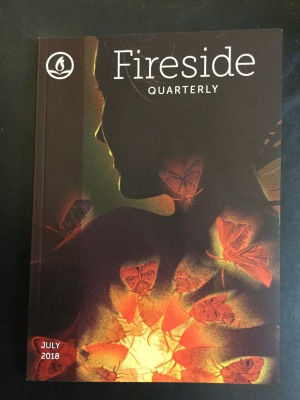 Photo of Fireside Quarterly July 2018 issue with cover artwork of a character covered with moths from A Taxonomy of Hurts by Kate Dollarhyde