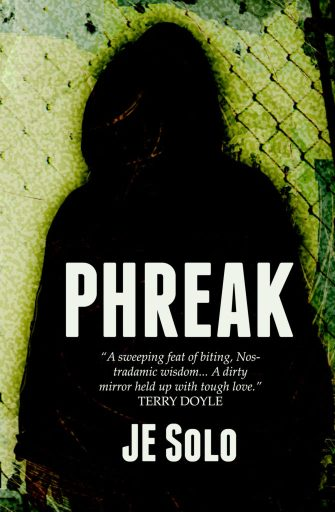 Book cover of Phreak by JE Solo with shadow of a person in hoodie against a chainlink fence
